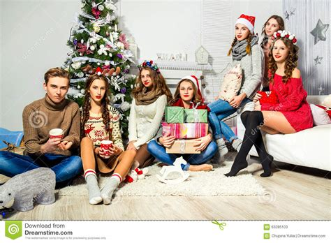 tree lihgt guys the company of six and near the tree stock image image 63285103