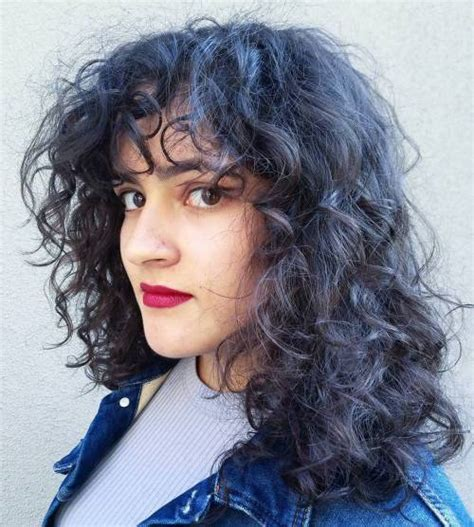 images medium length curly hair with fringe 40 cute styles featuring curly hair with bangs