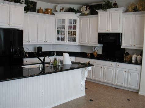 Painted Kitchen Cabinets With Black Appliances by Antique White Kitchen Cabinets With White Appliances