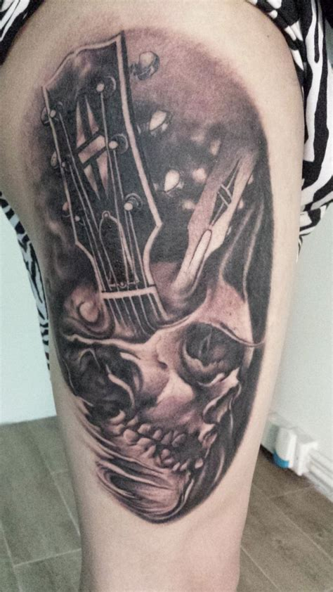 skull music tattoo designs skull with guitar black and gray on thigh
