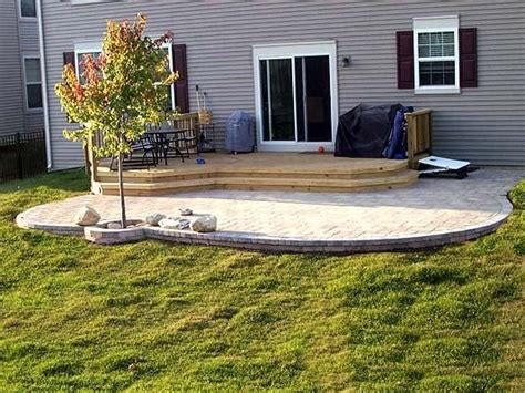 Paver Patio & Deck combination I love that the edge is