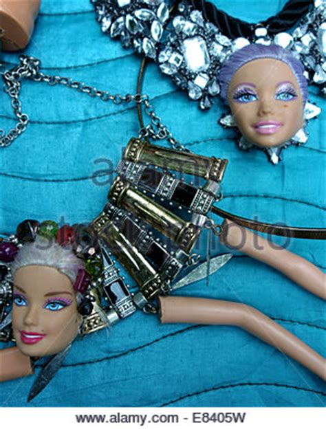 using doll parts jewelry using recycled ken doll parts by