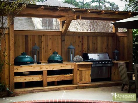 outdoor cooking area grill area fence combo also notice the big green egg