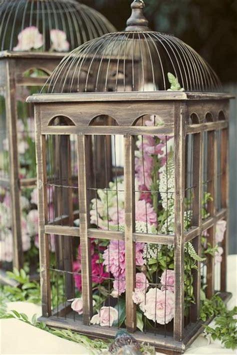 decorating a birdcage for a home unique vintage decor with beautiful flower arrangements