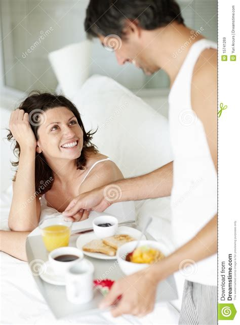 royalty free stock images happy husband serving breakfast