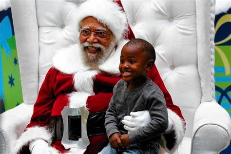 kids and adults flock to l a rarity black santa claus ktla