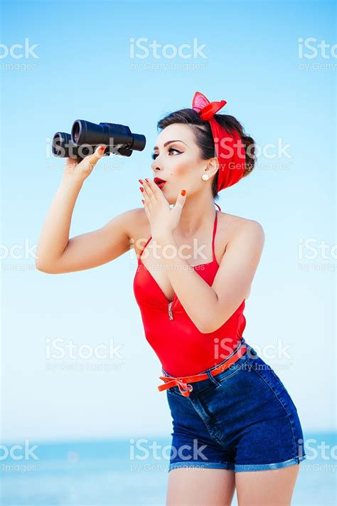 imagenes pin up pinup at sea with binoculars stock photo more pictures