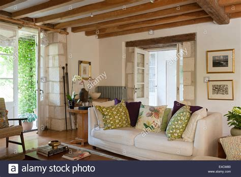 living room ceiling beams white sofa in living room with wooden ceiling beams and