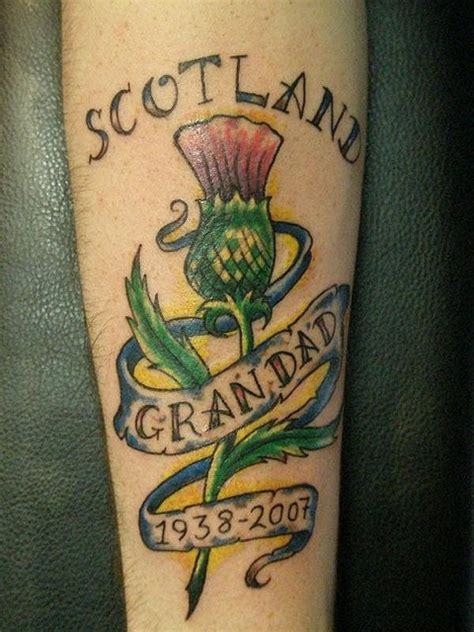 thistle scotland tattoo with lettering on arm