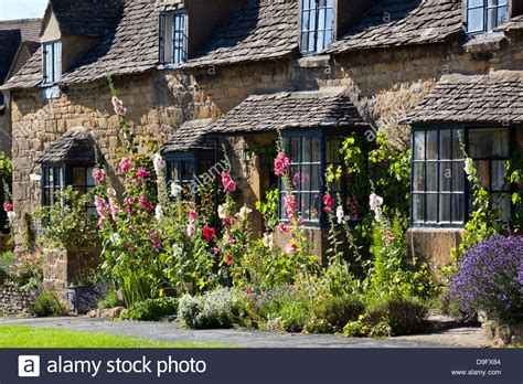 Cotswold Cottages Broadway by Hollyhocks And Cotswold Cottage Broadway Worcestershire