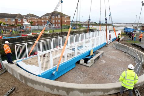swinging bridge marina place north west redrow invests in marina bridge at