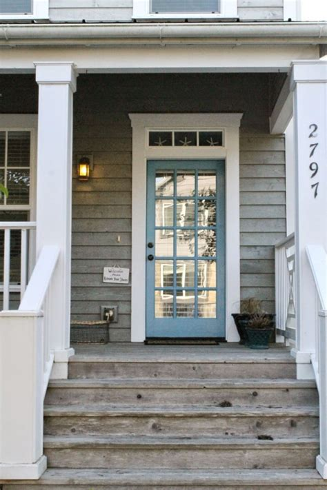 blue house white trim front door great porch love the worn wood white trim and blue door