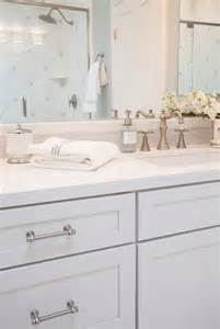 white shaker vanity cabinets with gray glass tile