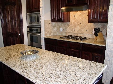 Giallo Ornamental Light Granite White Cabinets by Best 25 Giallo Ornamental Granite Ideas On