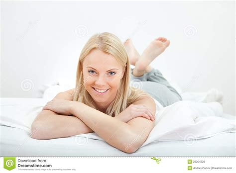 woman in bed young beautiful woman lying in bed royalty free stock