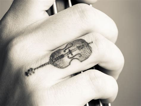 finger tattoo guitar freak out with 26 finger tattoo ideas