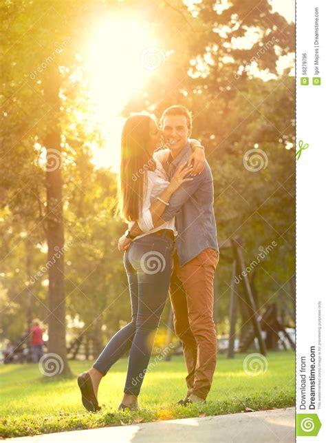 Cauple Senny hugging in park stock photo image 56279796