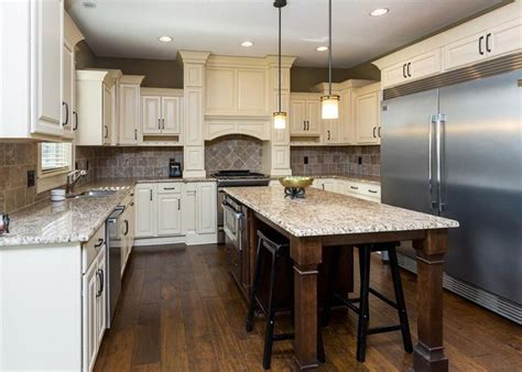 kitchens with white cabinets and dark floors antique white kitchen cabinets design photos designing