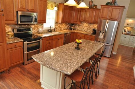 cherry cabinets with quartz countertops kitchen remodel using showplace cherry wood cabinetry