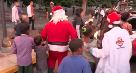 what clothes do venezuelans wear on christmas in santa claus brings food medicine to homeless in caracas