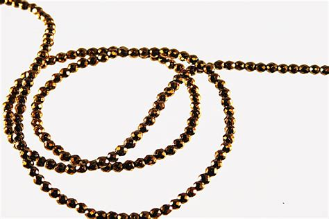 gold faceted faceted metallic gold 2mm bead string and more