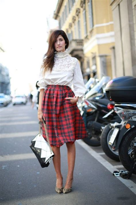 contains mostly with a color fashion world black and white bag colorful skirt and