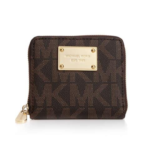 michael kors mk logo small zip around wallet in brown lyst
