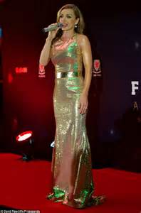 katherine jenkins wears glittering gold gown at faw awards
