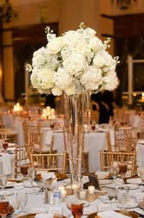 Flower Centerpieces For Weddings White Hydrangeas And Baby S Breath Make Beautiful Tall Floral Arrangements For Behind The Alter