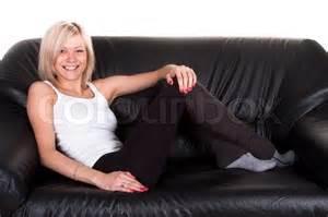 on the sofa sitting on the sofa stock photo colourbox