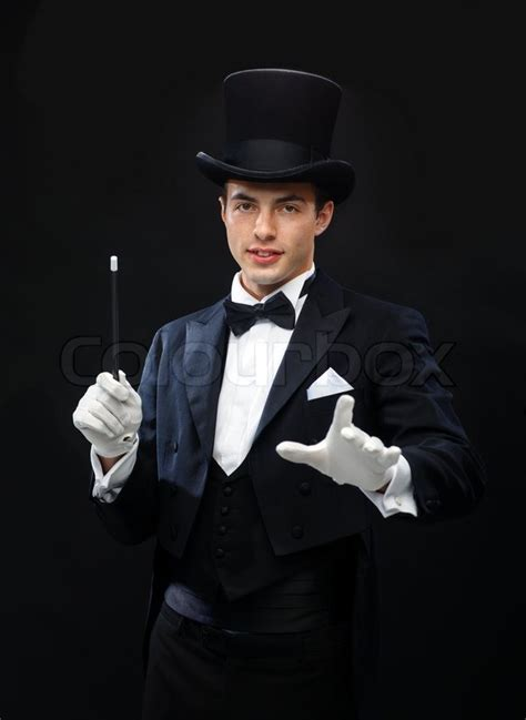 best magician magician in top hat with magic wand showing trick stock