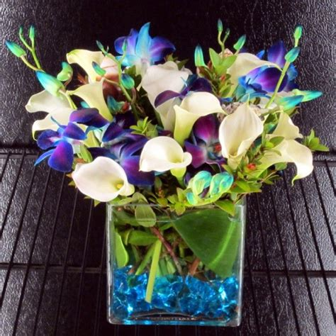 white mini calla lilies and 10 dyed blue bombay orchids