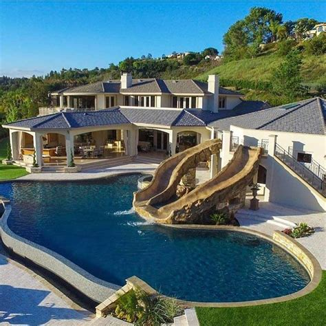 home with pool 15 luxury homes with pool millionaire lifestyle home house with sliding water pool