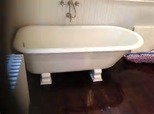 vintage cast iron bathtub on pedestal legs