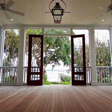 screened porch leading   charleston style garden