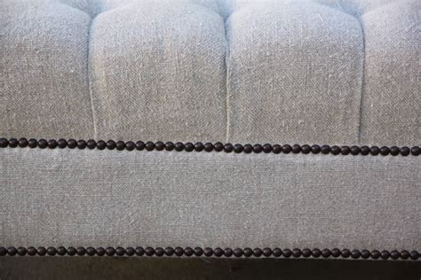 belgium linen upholstered ottoman w painted paw for sale at 1stdibs