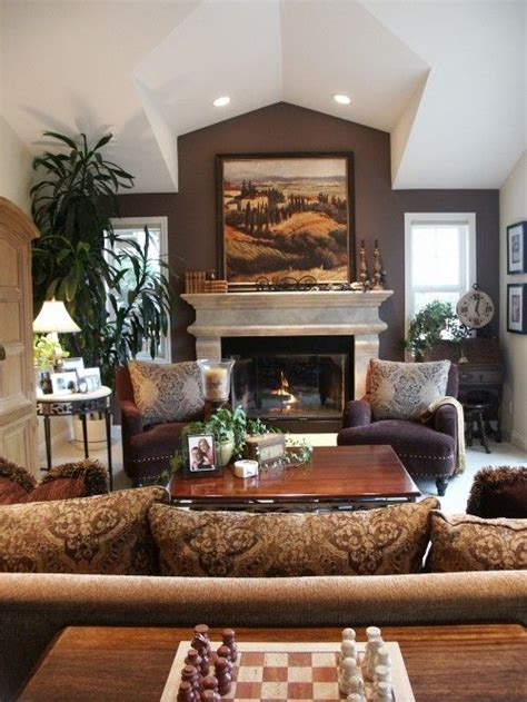 Warm Colors For Living Room Walls by Fireplaces Living Rooms And Chocolate Walls On