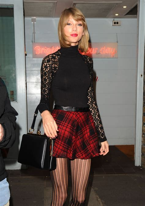 taylor swift london december taylor swift displays long legs in mini skirt cath