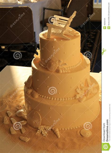 Wedding Cakes With Photos On Them by Three Layered Wedding Cake With Theme On Table Stock