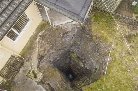 sinkhole in backyard sudden sinkhole 300 foot mine shaft opens in man s