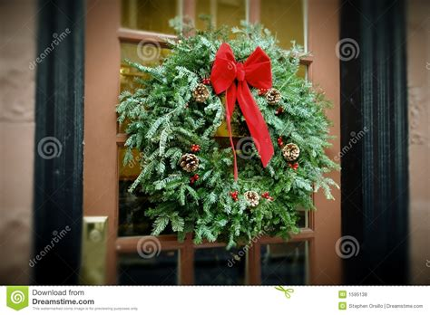 how to make a christmas door hanging on youtube antiqued wreath hanging on door stock photo image 1595138