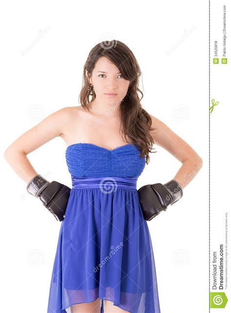 how to dress good for women i their 40s woman in dress and boxing glove on white stock photo