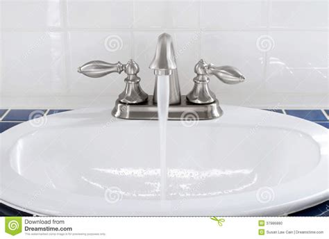 which side is water on a sink sink with running water stock photo image 37986880