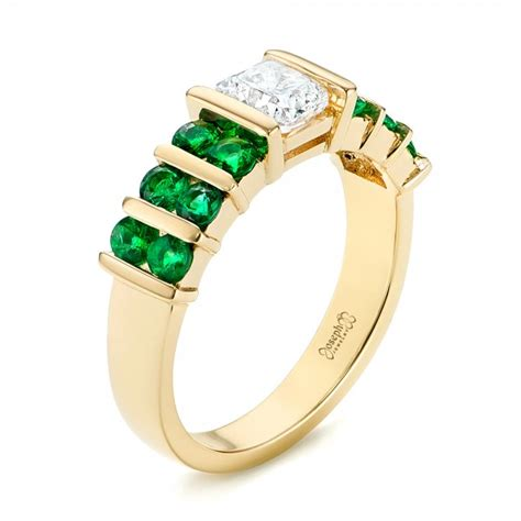 custom yellow gold emerald and engagement ring 103218