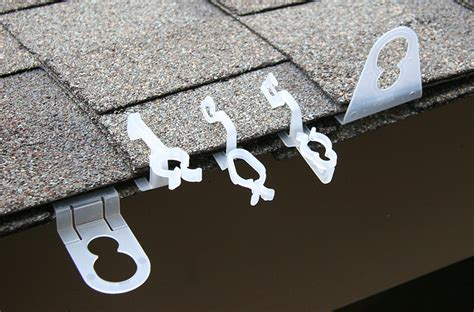 christmas light hanging ideas from gutters hanging lights