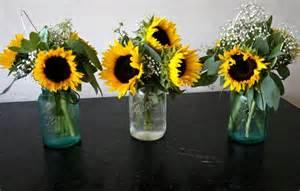 sunflower centerpieces sunflower centerpieces in jars rehearsal dinner decor jars and masons