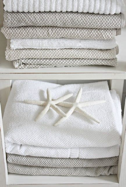 boat house linens create beachy vibe with neutral natural finishes beach
