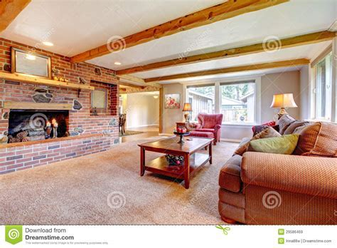 Living Room Interior With Brick Fireplace, Wood Beams And