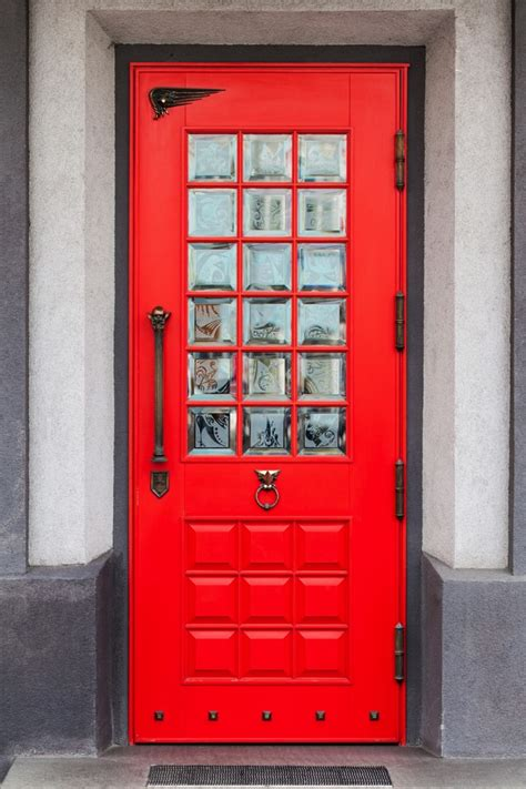 red door creating a charming entryway with red front doors