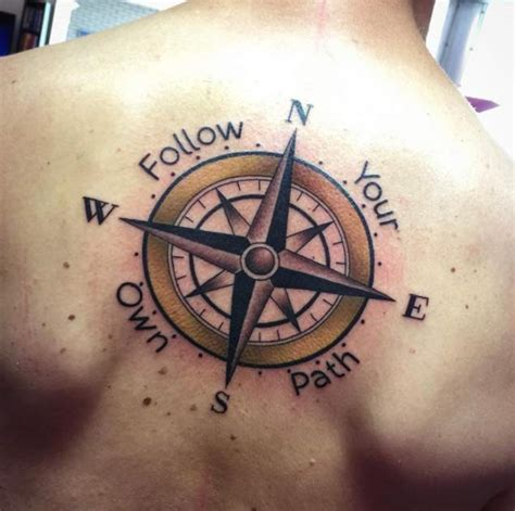 tattoo compass on back follow your own path compass tattoo on upper back